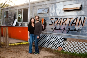 Nicole and her husband, Jeremy, in front of their pizza truck in Austin, Texas