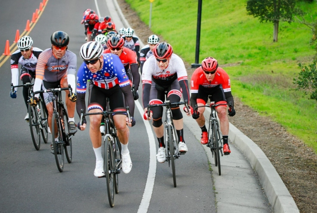 Jerome, (center, with blue jersey) competing in one of the many cycling races he participates in annually.