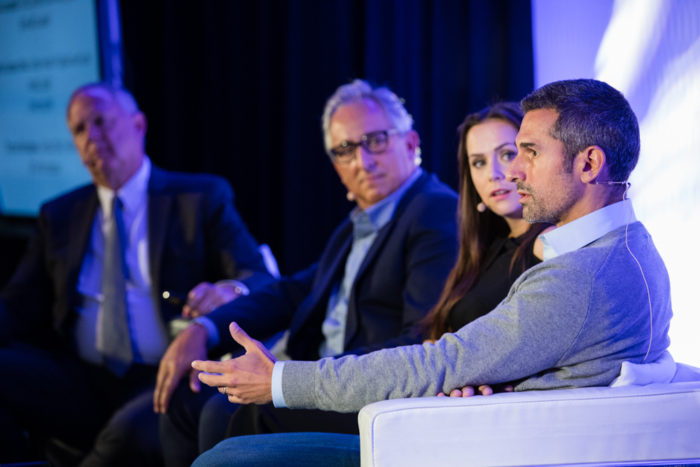 Thomas on a panel at the Europe Summit with Americo Silva and Ewa Campbell