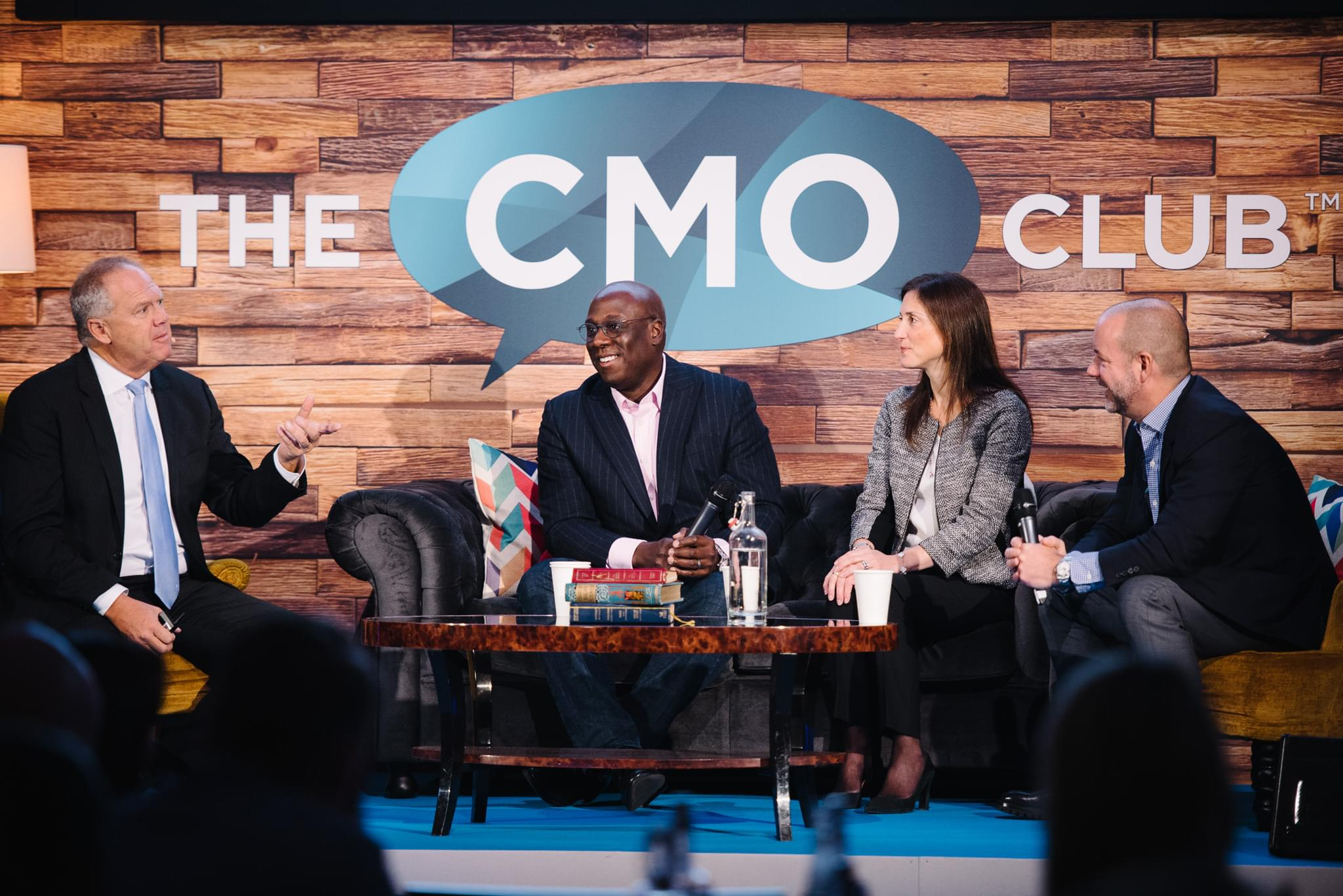 Photo of speakers at The CMO Club Summit